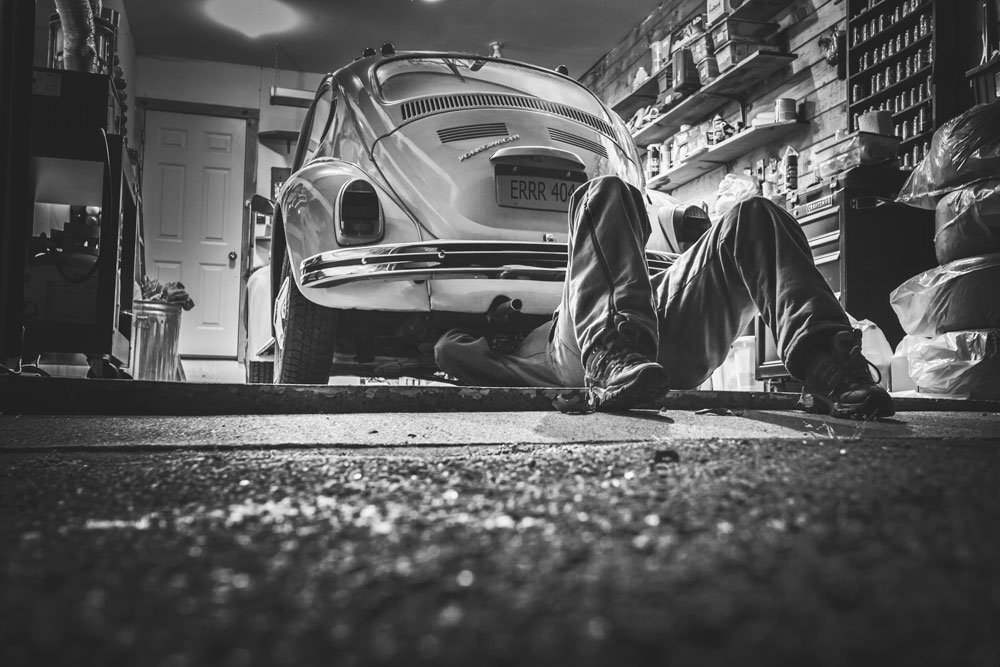 Website Mainteanance - mechanic working on car with 404 error license plate